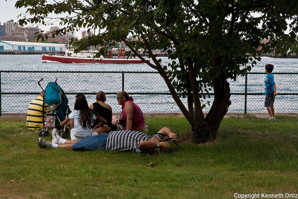 A family on Governors Island on a warm Summer day taking a moment to rest.
