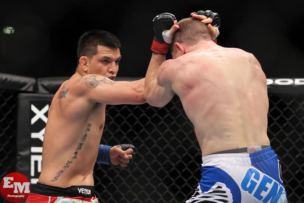 Atlanta, GA - April 21, 2012: Mac Danzig (blue trunks) and Efrain Escudero (red trunks) during UFC 145 at the Phillips Arena in Atlanta, Georgia.
