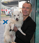 2019, December 01. Pathe ArenA, Amsterdam, the Netherlands. Raymond Thiry and his dog Eddie at the dutch premiere of The Addams Family.