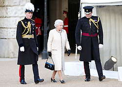 © Licensed to London News Pictures. 13/06/2013. London, UK. Her Majesty the Queen is seen at the Household Division's annual Beating Retreat parade at Horse Guards Parade in London. On two successive evenings each year in June a pageant of military music, precision marching and colour takes place on Horse Guards Parade in the heart of London when the Massed Bands of the Household Division carry out the Ceremony of Beating Retreat. 300 musicians, drummers and pipers perform this age-old ceremony. The Retreat has origins in the early days of chivalry when beating or sounding retreat pulled a halt to the days fighting. Photo credit: Matt Cetti-Roberts/LNP
