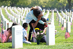 May 27, 2019, Los Angeles, California, U.S.: MATTHEW MARTINEZ pays respect to his brother on the Memorial Day at the Los Angeles National Cemetery. Californians are paying their respects on Memorial Day to those who have died serving their country. (Credit Image: © Jason Ryan/ZUMA Wire).