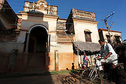A man rides his bike in front of a mansion in Kanadukathan. Numbering more than 25,000, Chettinad's mansions were built by a Hindu caste of Chettiars called the Nagarathars. They were bankers and merchants who made their fortunes outside India in Burma, Malaysia, Vietnam and Singapore during the times of the British colonialism. With this new found fortunes they built mansions, exquisite palaces that rivaled those of even the Maharajah's using teak from Burma, marble form Italy, tiles from Japan and steel from England. But these glory days only lasted until after the WWII when the British left Burma and they were forced to leave return to India. Suddenly with no income their mansions began to decay and fall down or were pulled take and the pillars, windows, doors and antiques were sold. Some estimates say that around 20 per month are coming down. Hopefully, with the aid of preservation projects such as the Revive Chettinad Society, and the influx of tourism these mansions can be saved before they all fall down.