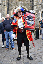 A man dressed as a town crier outside Windsor Castle in Berkshire following the news of the birth of the Duke and Duchess of Sussex's new baby boy.