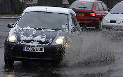 © Licensed to London News Pictures. 11/02/2013.The snow has returned today (11,02,2013) to Kent and the South East.A  Snow covered car hits a puddle of water in Pettswood near Bromley in South East London..Photo credit : Grant Falvey/LNP