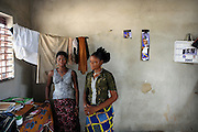 African girls waiting inside of their room in Cotonou, Benin on February 29, 2008.