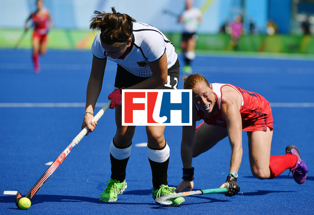 Germany's Charlotte Stapenhorst (L) vies with The USA's Lauren Crandall during the women's quarterfinal field hockey USA vs Germany match of the Rio 2016 Olympics Games at the Olympic Hockey Centre in Rio de Janeiro on August 15, 2016. / AFP / Pascal GUYOT        (Photo credit should read PASCAL GUYOT/AFP/Getty Images)
