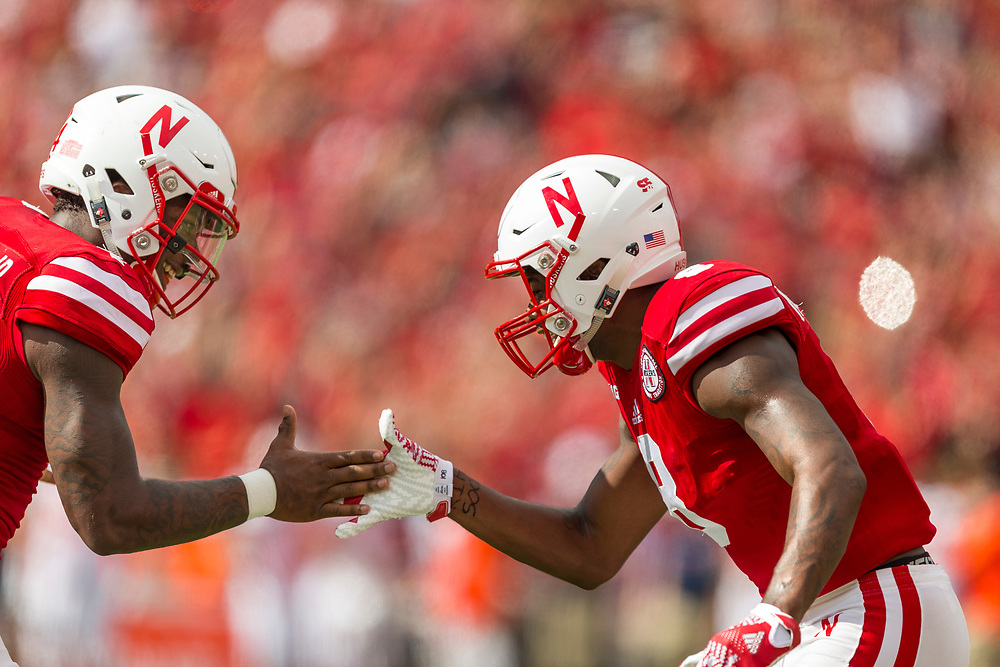 Tommy Armstrong Jr. #4 of the Nebraska Cornhuskers celebrates with Stanley Morgan Jr. #8 of the Nebraska Cornhuskers after a touchdown during Nebraska's game against Illinois at Memorial Stadium in Lincoln, Neb. on Oct. 1, 2016. Photo by Aaron Babcock, Hail Varsity
