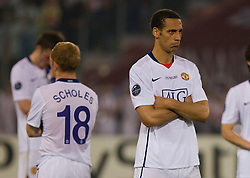 ROME, ITALY - Tuesday, May 26, 2009: Manchester United's Rio Ferdinand looks dejected after his side lose 2-0 to Barcelona during the UEFA Champions League Final at the Stadio Olimpico. (Pic by Carlo Baroncini/Propaganda)