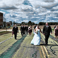 Small town weddings make unique shots like this possible! The wedding party walked down the street.