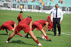 Roma coach Claudio Ranieri watches his players warm up before the game between Siena and Roma. Serie A, 13th September 2009.