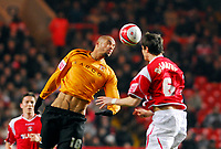 Photo: Leigh Quinnell/Sportsbeat Images.<br /> Charlton Athletic v Hull City. Coca Cola Championship. 22/12/2007. Hulls Caleb Folan rises for the ball with Charltons  Patrick McCarthy.