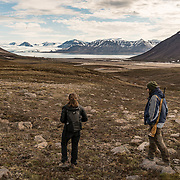 Trekking above Goose Lake in the valley above Pyramiden.