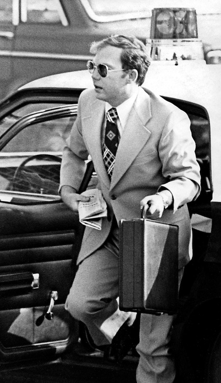 "Convicted of the murder of 102 VietNamese civilians - the My Lai Massacre - former U.S. Army Lieutenant William Calley (sunglasses) is escorted from the Fort Benning, Georgia confinement facility to a federal appeals court in nearby Columbus, Ga. At a later date, Calley's original sentence of life in prison was turned into an order of house arrest, but after three years, President Richard Nixon reduced his sentence with a presidential pardon -- Determine pricing and license this image, simply by clicking ""Add To Cart"" below --"