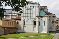 Kids playing football against one of the many medieval churches in Lucca, Tuscany, Italy.