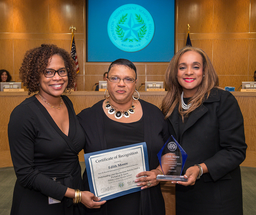 Houston ISD Board of Trustees president Rhonda Skillern-Jones, right, recognizes retired Lanier Middle school teacher Edith Moore, center, during a board meeting January 15, 2015.