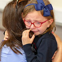 An emotional Sarah McGrath with mammy Michelle on her first day at school at Scoil Na Mainistreach Quin Dangan