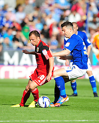 Bristol City's Jody Morris battles for the ball with Leicester City's David Nugent - Photo mandatory by-line: Joe Meredith/JMP  - Tel: Mobile:07966 386802 06/10/2012 - Leicester City v Bristol City - SPORT - FOOTBALL - Championship -  Leicester  - King Power Stadium