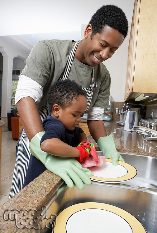 Man and Son Washing Dishes