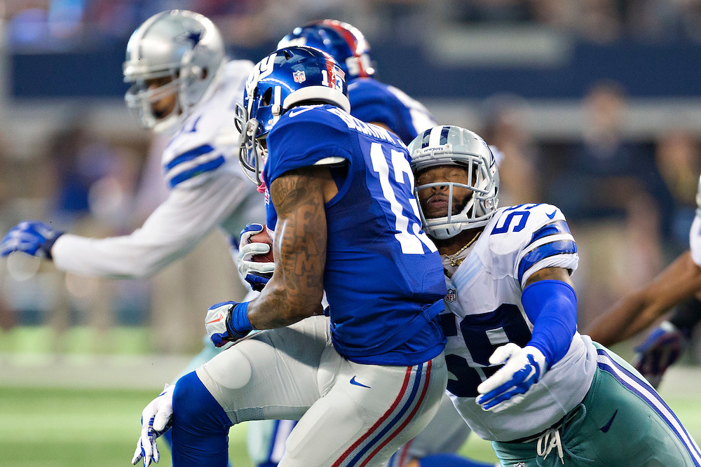 ARLINGTON, TX - OCTOBER 19:  Odell Beckham Jr. #13 of the New York Giants is tackled by Anthony Hitchens #59 of the Dallas Cowboys at AT&T Stadium on October 19, 2014 in Arlington, Texas.  The Cowboys defeated the Giants 31-21.  (Photo by Wesley Hitt/Getty Images) *** Local Caption *** Odell Beckham Jr.; Anthony Hitchens