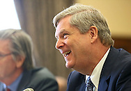 Agriculture Secretary Tom Vilsack laughs as he talks with Representative Robert Aderholt (R-AL) before the start of a hearing with the House Appropriations Agriculture subcommittee on the USDA's fiscal 2014 budget proposal in the Rayburn House Office Building in Washington, DC on Tuesday, April 16, 2013. Aderholt is the chairman of the Agriculture subcommittee.