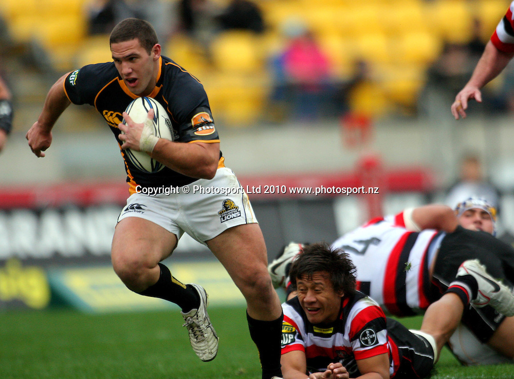 Shaun Treeby beats the tackle of Counties Manukau fullback Tim Nanai-Williams. ITM Cup - Wellington Lions v Counties-Manukau Steelers at Westpac Stadium, Wellington, New Zealand on Sunday, 8 August 2010. Photo: Dave Lintott/PHOTOSPORT
