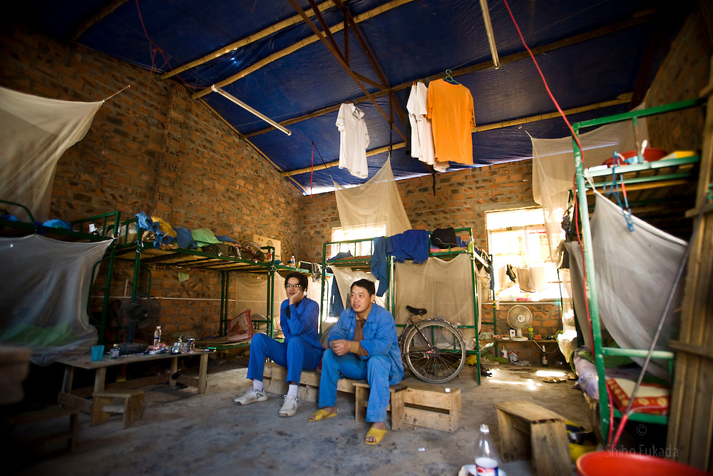 Chinese workers rest at the dorm near the Haiphong Thermal Power Plant construction site in Trung Son, Vietnam, Nov. 22, 2009. At the construction site here, a few miles northeast of the port city of Haiphong, an entire Chinese world has sprung up, including four walled dormitory compounds for the Chinese workers, restaurants with Chinese signs advertising dumplings and fried rice, and currency exchange shops.