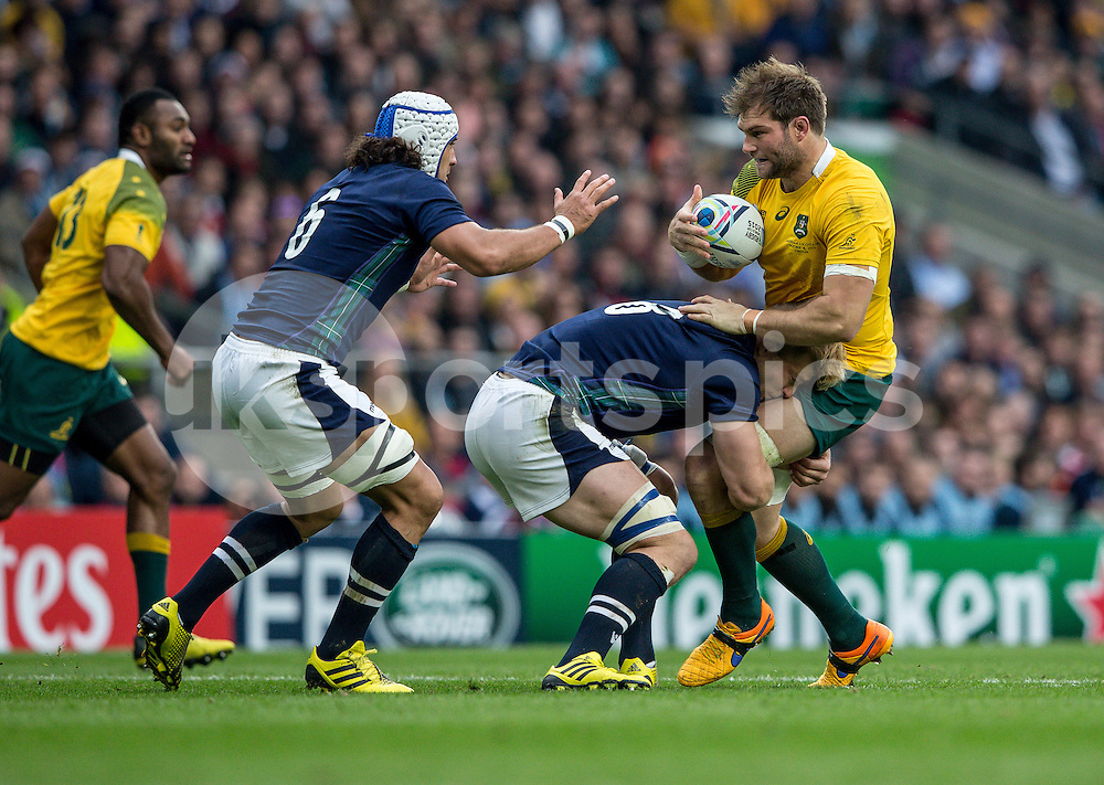 Ben McCalman of Australia is stopped by David Denton of Scotland during the Rugby World Cup Quarter Final match between Australia and Scotland played at Twickenham Stadium, London on the 18th of October 2015. Photo by Liam McAvoy.