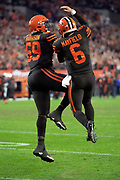 Cleveland Browns rookie quarterback Baker Mayfield (6) leaps and celebrates with Cleveland Browns rookie offensive tackle Desmond Harrison (69) after Mayfield catches a third quarter pass for a successful two point conversion that ties the score at 14-14 during the 2018 NFL regular season week 3 football game against the New York Jets on Thursday, Sept. 20, 2018 in Cleveland. The Browns won the game 21-17. (©Paul Anthony Spinelli)