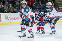 KELOWNA, CANADA - JANUARY 11: Carter Rigby #11 and Riley Stadel #3 of the Kelowna Rockets skates on the ice against the Tri City Americans at the Kelowna Rockets on January 11, 2013 at Prospera Place in Kelowna, British Columbia, Canada (Photo by Marissa Baecker/Shoot the Breeze) *** Local Caption ***