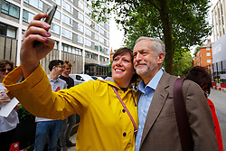 © Licensed to London News Pictures. 27/08/2015. London, UK. Labour Party leader candidate Jeremy Corbyn posing for a picture with a supporter before attending a husting hosted by Daily Mirror at DoubleTree Hilton Hotel in London on Thursday, August 27, 2015. Photo credit: Tolga Akmen/LNP