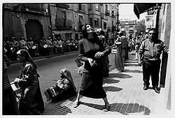 Alca&ntilde;iz, Teruel, Spain.<br /> A woman in an Easter procession.&copy;Carmen Secanella
