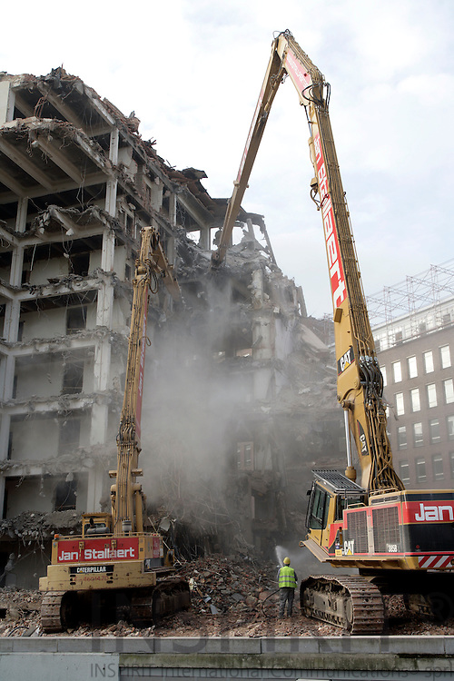 BRUSSELS - BELGIUM - 28 NOVEMBER 2006 -- The old Commission building at Ave. de la Joyeuse Entree being demolished by large construction machines.    PHOTO: ERIK LUNTANG /