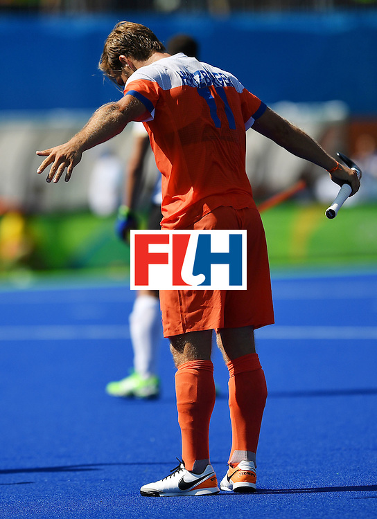 Netherland's Seve van Ass celebrates scoring a goal during the men's field hockey Argentina vs Netherlands match in the Rio 2016 Olympics Games on August, 6 2016 at the Olympic Hockey Centre in Rio. / AFP / Carl DE SOUZA        (Photo credit should read CARL DE SOUZA/AFP/Getty Images)