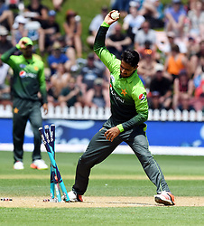 Pakistan's Amir Yamin throw the ball into the turf in disgust after missing running out New Zealand's Colin de Grandhomme in the fifth one day International Cricket match, Basin Reserve, Wellington, New Zealand, Friday, January 19, 2018