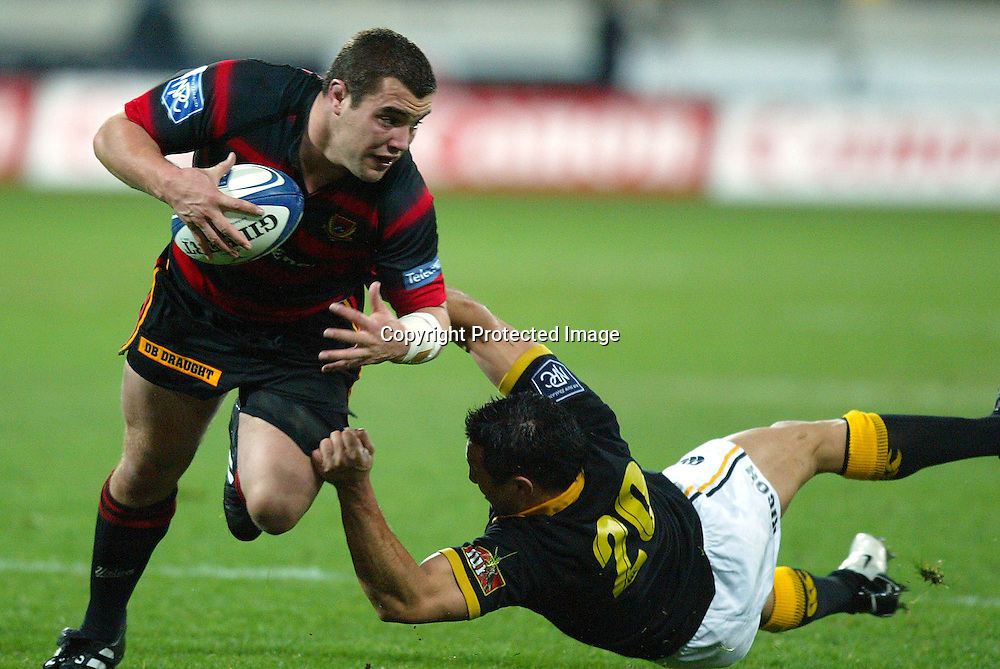 3 August 2004, Westpac Stadium, Wellington, <br /> New Zealand, Rugby Union, NPC Div 1<br /> Wellington Lions vs Canterbury<br /> Canterbury's Corey Flynn gets tackled by Lion's Riki Flutey during Wellington's 34-22 win over Canterbury on Friday night.<br /> Please Credit: Marty Melville/Photosport