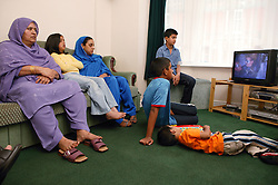 Family at home watching the television,