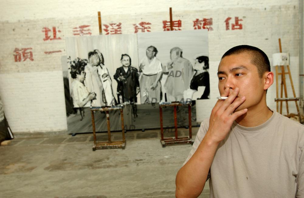 """Li Songsong in his studio at """"798"""" gallery."""