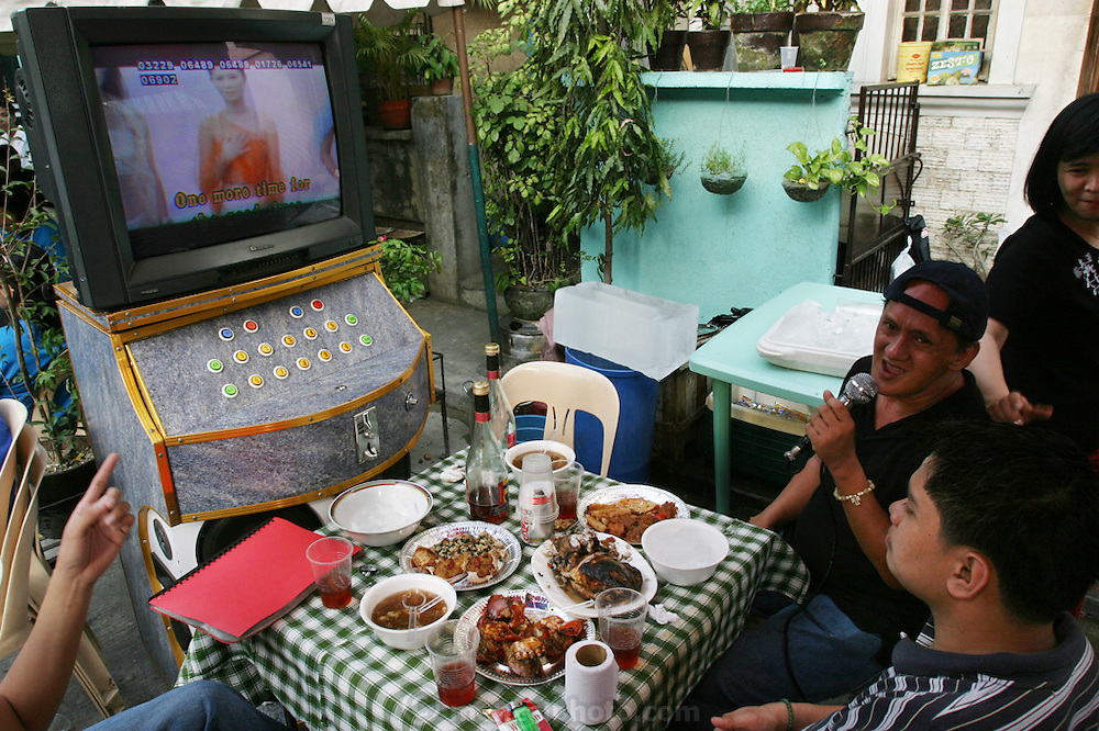 A karaoke lunch of chicken, crabs, soup, and spring rolls in Manila, Philippines. (From a photographic gallery of meals in Hungry Planet: What the World Eats, p. 245).