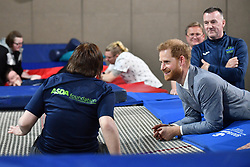 Britain's Prince Harry, Duke of Sussex interacts with a participant of the Rebound Therapy session as he visits the OXSRAD Disability Sports and Leisure Centre, in Oxford, southern England on May 14, 2019, during a visit to highlight positive work underway in the area to support the needs of children, young people and adults. (Photo by Daniel LEAL-OLIVAS / various sources / AFP)