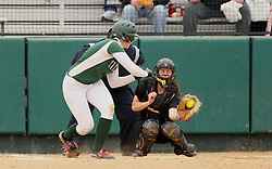 30 March 2013:  Stephanie Polich during an NCAA Division III women's softball game between the DePauw Tigers and the Illinois Wesleyan Titans in Bloomington IL<br />
