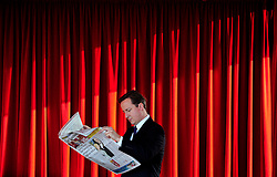 Leader of the Conservative Party David Cameron reads the Sunday papers in the green room at the Hilton Hotel in Manchester before  going on the Andrew Marr show on the eve of the Conservative Party Conference in Manchester, 2009. Photo By Andrew Parsons / i-Images.