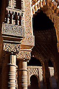 Detail of columns, capitals and pilasters, Courtyard of the Lions, 1362 ? 1391, Muhammad V, Nasrid Palaces, The Alhambra, Granada, Andalusia, Spain. Picture by Manuel Cohen