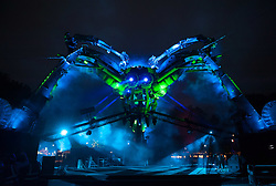 © Licensed to London News Pictures. 03/09/2015. Bristol, UK.  Bristol's historic Queen Square is lit up during the dress rehearsal of the world's first recycled biofuel pyrotechnics show, Arcadia's new Metamorphosis show. The 50-tonne Arcadia spider, made from repurposed military hardware and fuelled by waste oil from local fish and chip shops, has landed in the city this weekend to celebrate its year as European Green Capital 2015.  Photo credit : Simon Chapman/LNP