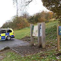 Perth Manhunt.....24.10.12<br /> Police officers pictured near Kinnoull Hill in Perth today joining a manhunt for prisoner Lee Cyrus who has absconded from North Sea Camp, Boston, Lincs..Police decended on the area around Kinnoull Hill sealing it off after a possible sighting of Lee Cyrus was reported using a helicopter and dogs to search the wooded Perthshire beauty spot.<br /> Picture by Graeme Hart.<br /> Copyright Perthshire Picture Agency<br /> Tel: 01738 623350  Mobile: 07990 594431