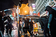 HONG KONG: 13 October 2019 <br /> Protesters vandalise a traffic light in the Mong Kok area of Hong Kong this evening as demonstrators move into their 19th consecutive week of protests. The movement's aim, which started on June 1st, originally wanted to get rid of a controversial extradition bill which has since been removed, however the protests have formed into a wider fight against police brutality and the ability to wear a mask without fear of arrest.<br /> Rick Findler / Story Picture Agency