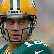 Green Bay Packers quarterback Aaron Rodgers takes the field prior to the start of an NFL pre-season football game between the Green Bay Packers and Oakland Raiders Friday Aug. 22, 2014, in Green Bay, Wis. (AP Photo/Matt Ludtke)