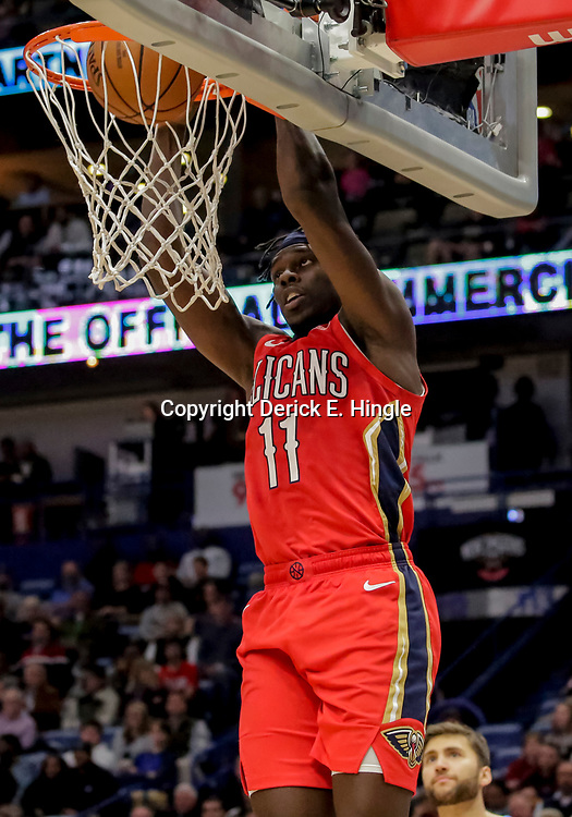 Dec 5, 2018; New Orleans, LA, USA; New Orleans Pelicans guard Jrue Holiday (11) dunks against the Dallas Mavericks during the second half at the Smoothie King Center. Mandatory Credit: Derick E. Hingle-USA TODAY Sports