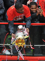 Manchester United players parade the Premier League trophy in Deansgate, Manchester, to waiting fans during the Premier League winners parade, Monday  May 30, 2011. Photo By Andrew Parsons / i-Images