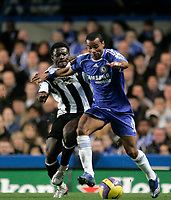 Photo: Marc Atkins.<br /> Chelsea v Newcastle United. The Barclays Premiership. 13/12/2006. Ashley Cole of Chelsea in action with Obafeme Martins of Newcastle.