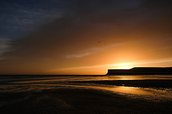 © Licensed to London News Pictures. <br /> 29/09/2016. <br /> Saltburn-by-the-Sea, UK.  <br /> <br /> A dramatic dawn sky can is seen over the cliffs and beach at Saltburn by the Sea.<br /> <br /> Photo credit: Ian Forsyth/LNP